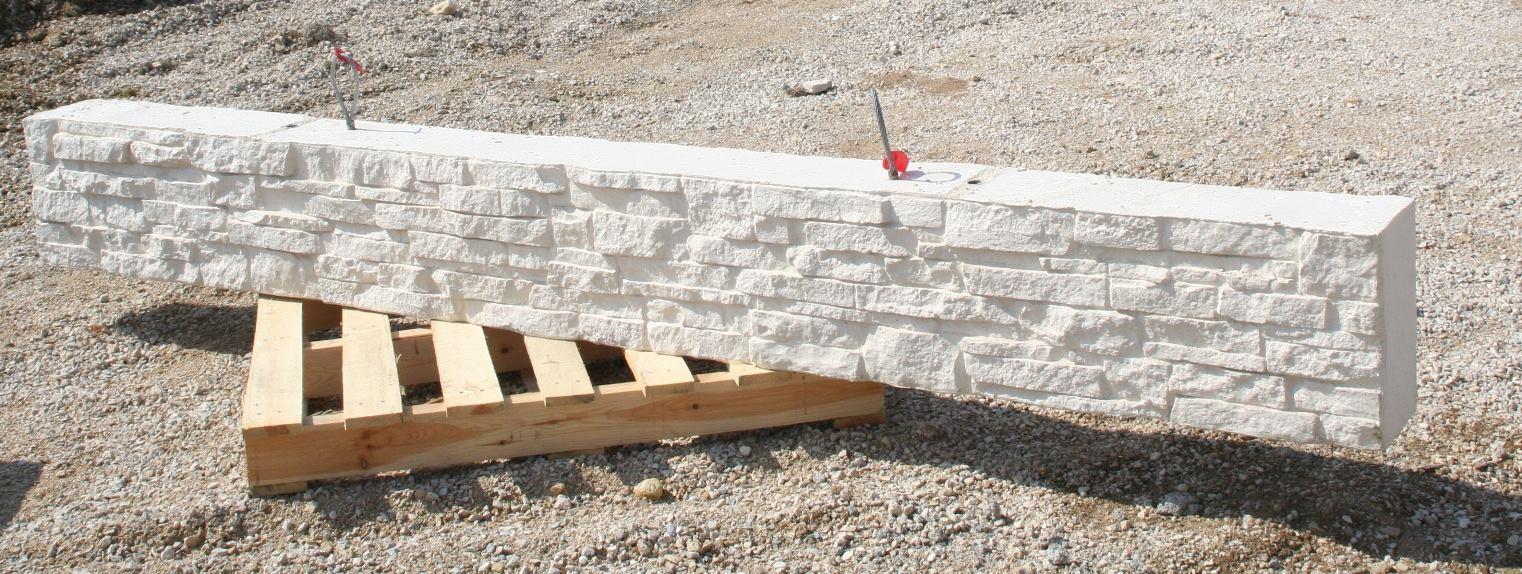 Muret de clôture droit, finition 'pierres sèches' sur une face, longueur 5 m.
